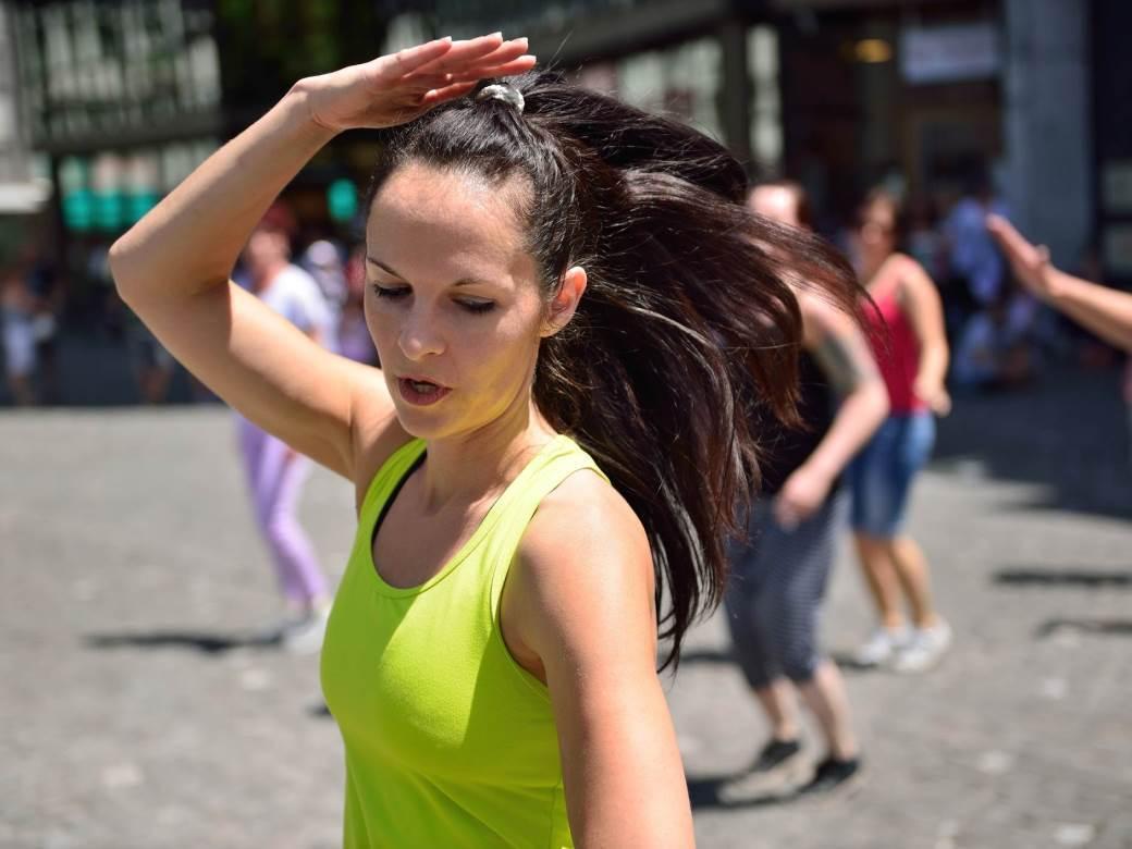 Flashmob on the street on a sunny day