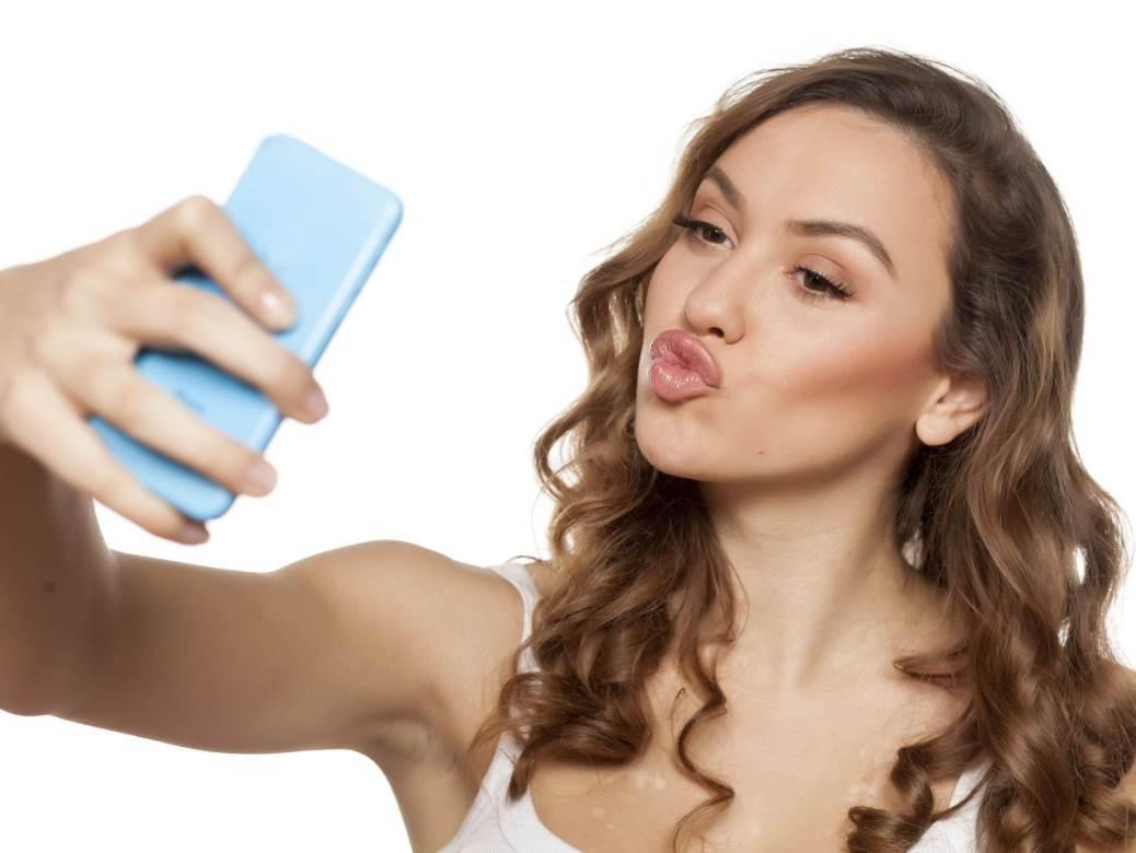 sensual young woman making selfie