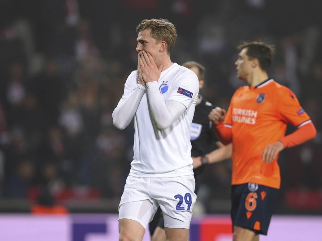 Copenhagen's Mikkel Kaufmann, centre, reacts, during a Europa League top 16 first leg soccer match between Basaksehir and Copenhagen, in Istanbul, Thursday, March 12, 2020. (AP Photo)