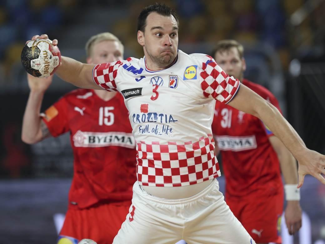 Croatia's Marino Maric shoots during the World Handball Championship game against Denmark in Cairo, Egypt, Monday, Jan. 25, 2021. (Mohamed Abd El Ghany, Pool via AP)
