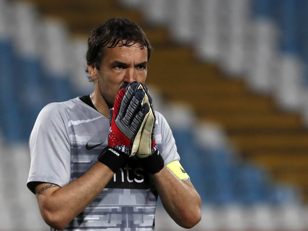 Partizan's goalkeeper Vladimir Stojkovic reacts during Serbia's national Cup final soccer match between Red Star and Partizan, in Belgrade, Serbia, Tuesday, May 25, 2021. (AP Photo/Darko Vojinovic)