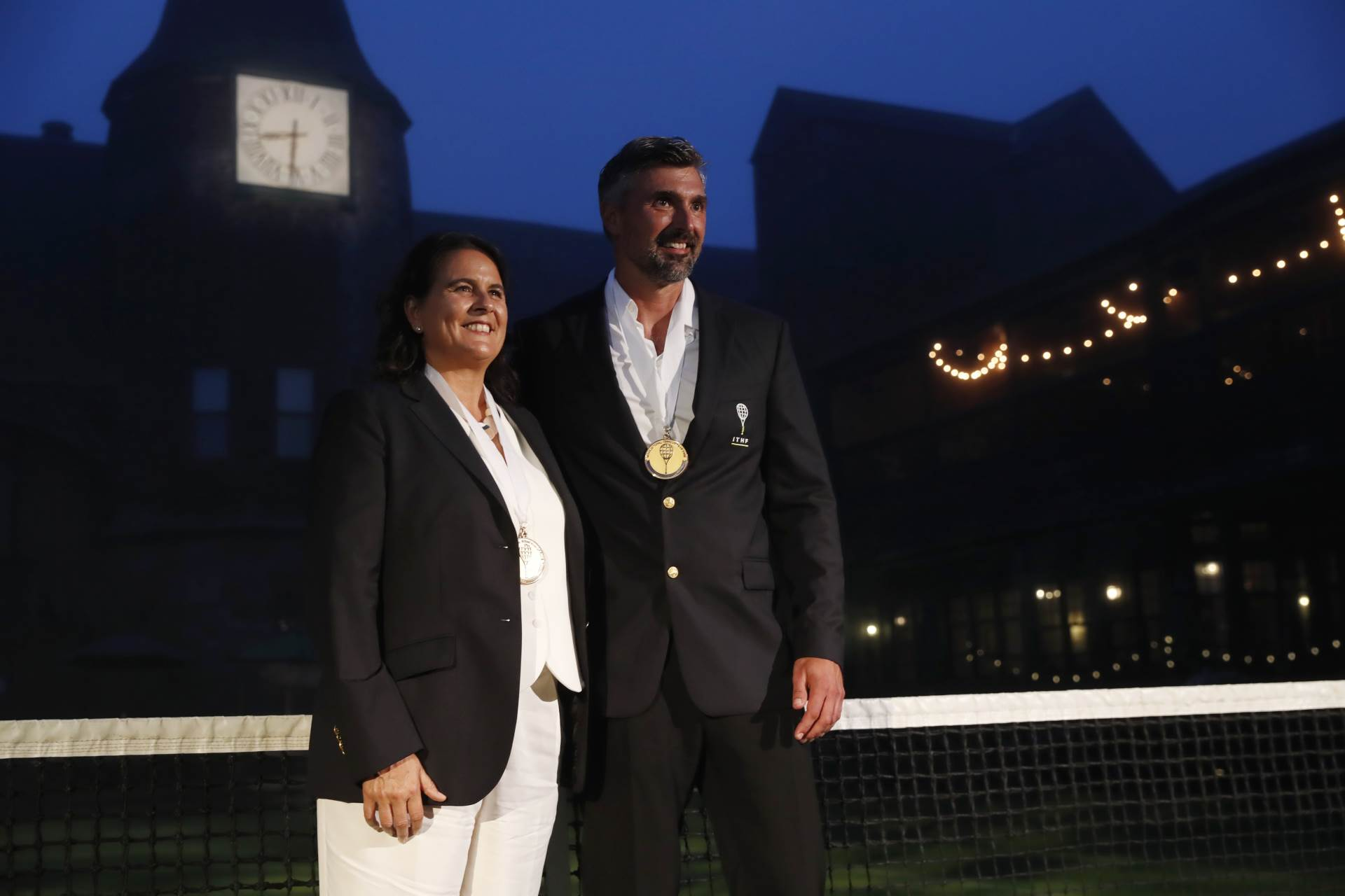 Conchita Martinez, left, and Goran Ivanisevic pose after being inducted into the International Tennis Hall of Fame, Saturday, July 17, 2021, in Newport, R.I. (AP Photo/Michael Dwyer)