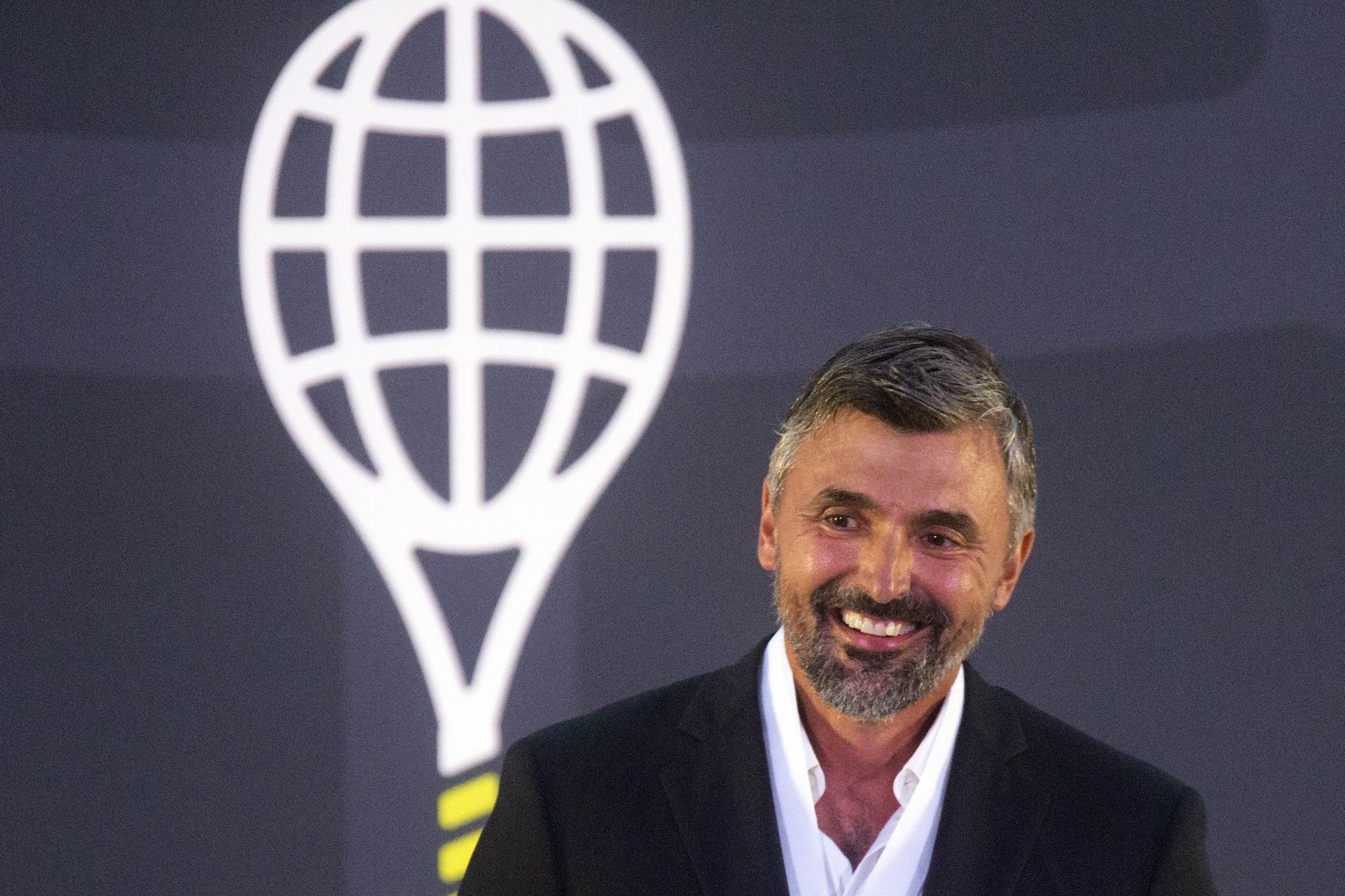 Goran Ivanisevic speaks after being inducted into the International Tennis Hall of Fame, Saturday, July 17, 2021, in Newport, R.I. (AP Photo/Michael Dwyer)