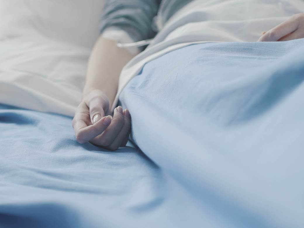 patient-in-a-hospital-bed-with-iv-drip-YE3K5CC